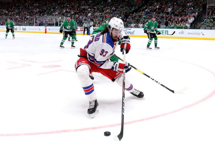 DALLAS, TEXAS - MARCH 10: Mika Zibanejad #93 of the New York Rangers skates the puck against the Dallas Stars during the second period at American Airlines Center on March 10, 2020 in Dallas, Texas. (Photo by Ronald Martinez/Getty Images)