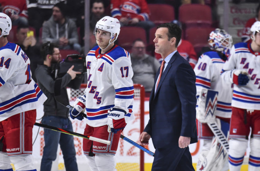 : Head coach of the New York Rangers David Quinn walks across the rink after a victory against the Montreal Canadiens at the Bell Centre on February 27, 2020 in Montreal, Canada. The New York Rangers (Photo by Minas Panagiotakis/Getty Images)