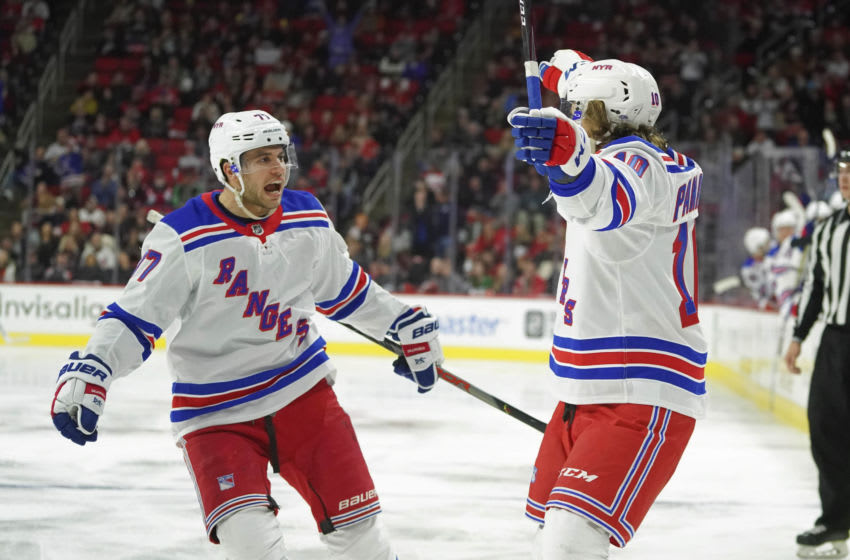 Feb 21, 2020; Raleigh, North Carolina, USA; New York Rangers left wing Artemi Panarin (10) celebrates his third period goal with defenseman Tony DeAngelo (77) against the Carolina Hurricanes at PNC Arena. The New York Rangers defeated the Carolina Hurricanes 5-2. Mandatory Credit: James Guillory-USA TODAY Sports