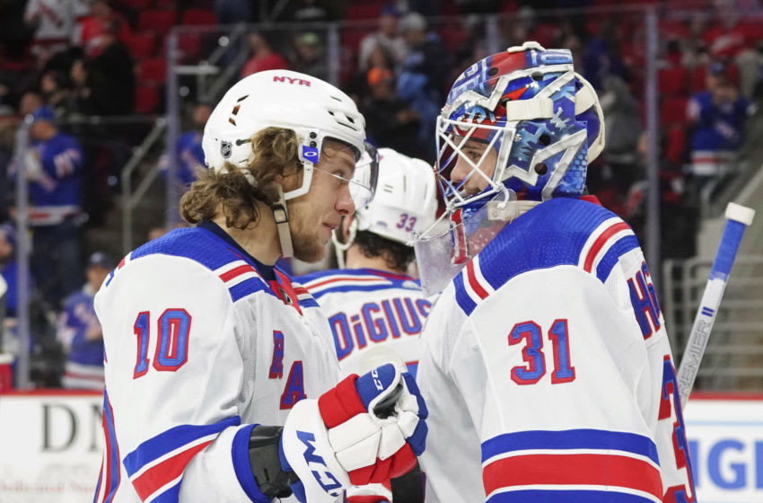 Feb 21, 2020; Raleigh, North Carolina, USA; New York Rangers goaltender Igor Shesterkin (31) and left wing Artemi Panarin (10) celebrate there win against the Carolina Hurricanes at PNC Arena. The New York Rangers defeated the Carolina Hurricanes 5-2. Mandatory Credit: James Guillory-USA TODAY Sports