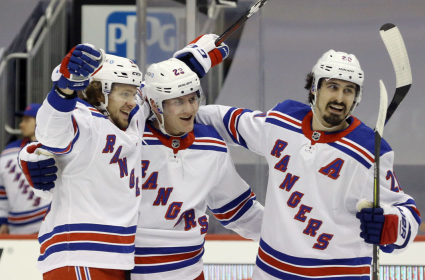 Jan 22, 2021; Pittsburgh, Pennsylvania, USA; New York Rangers defenseman Adam Fox (23) celebrates his goal with New York Rangers left wing Artemi Panarin (10) and left wing Chris Kreider (20) against the Pittsburgh Penguins during the second period at the PPG Paints Arena. Pittsburgh won 4-3 in a shoot-out. Mandatory Credit: Charles LeClaire-USA TODAY Sports