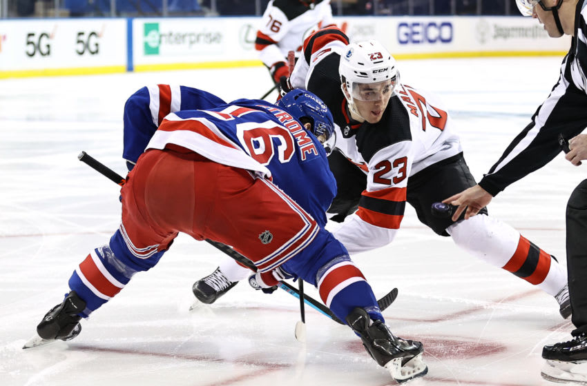 Mikhail Maltsev #23 of the New Jersey Devils and Ryan Strome #16 of the New York Rangers face off. Credit: Elsa/POOL PHOTOS-USA TODAY Sports