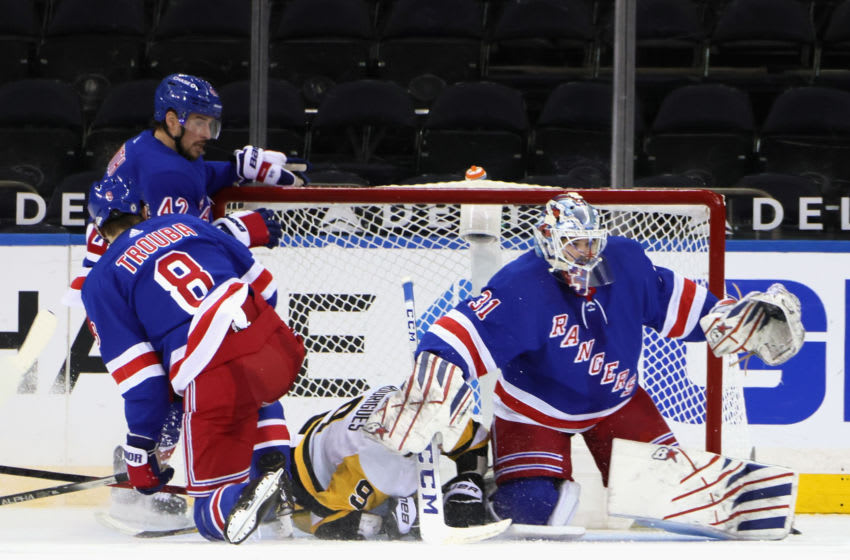 Apr 6, 2021; New York, New York, USA; Igor Shesterkin #31 of the New York Rangers makes the second period save as Evan Rodrigues #9 of the Pittsburgh Penguins slides into the net at Madison Square Garden on April 06, 2021 in New York City. Mandatory Credit: Bruce Bennett/POOL PHOTOS-USA TODAY Sports