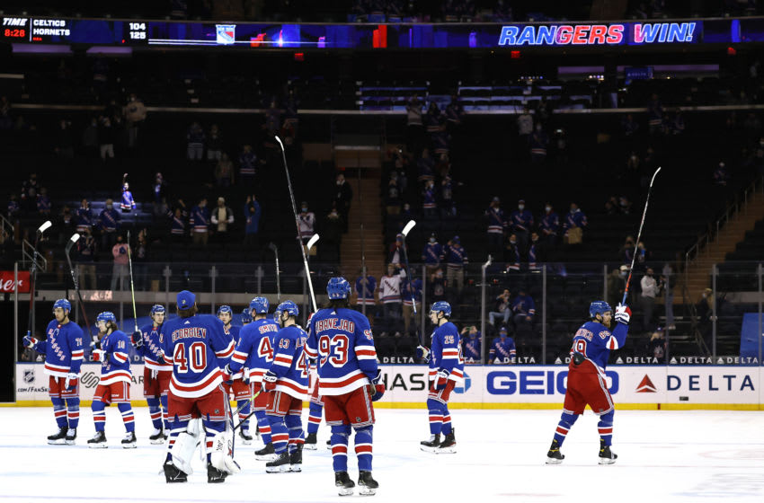 Mika Zibanejad #93 of the New York Rangers and the rest of his teammates celebrate the win (Credit: Elsa/Pool Photo-USA TODAY Sports)