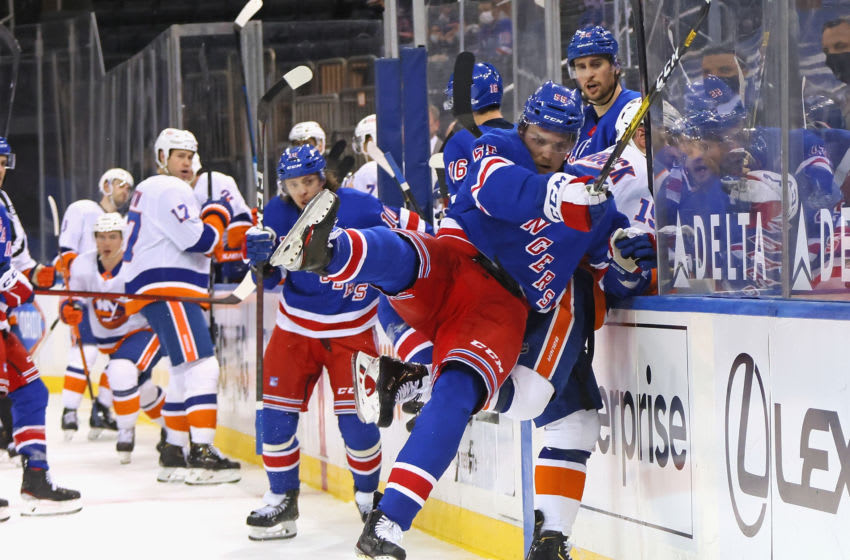 Apr 29, 2021; New York, New York, USA; Ryan Lindgren #55 of the New York Rangers is injured as he checks Cal Clutterbuck #15 of the New York Islanders into the glass during the third period at Madison Square Garden on April 29, 2021 in New York City. Mandatory Credit: Bruce Bennett/Pool Photo-USA TODAY Sports
