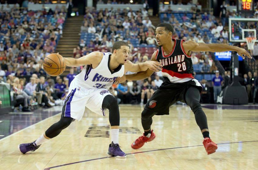 Oct 10, 2015; Sacramento, CA, USA; Sacramento Kings guard Seth Curry (30) drives in against Portland Trail Blazers guard Phil Pressey (26) during the fourth quarter at Sleep Train Arena. The Sacramento Kings defeated the Portland Trail Blazers 94-90. Mandatory Credit: Kelley L Cox-USA TODAY Sports