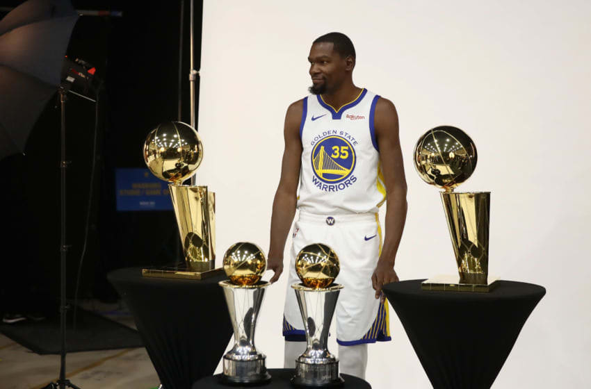 OAKLAND, CA - SEPTEMBER 24: Kevin Durant #35 of the Golden State Warriors poses with two Larry O'Brien NBA Championship Trophies and two NBA Finals MVP trophies during the Golden State Warriors media day on September 24, 2018 in Oakland, California. (Photo by Ezra Shaw/Getty Images)
