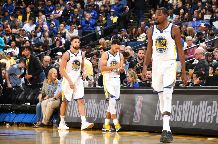 OAKLAND, CA - OCTOBER 16: Klay Thompson #11, Stephen Curry #30 and Kevin Durant #35 of the Golden State Warriors are photographed during the game against the Oklahoma City Thunder on October 16, 2018 at ORACLE Arena in Oakland, California. NOTE TO USER: User expressly acknowledges and agrees that, by downloading and or using this photograph, user is consenting to the terms and conditions of Getty Images License Agreement. Mandatory Copyright Notice: Copyright 2018 NBAE (Photo by Andrew D. Bernstein/NBAE via Getty Images)