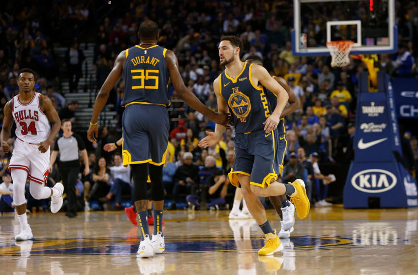 OAKLAND, CA - JANUARY 11: Kevin Durant #35 and Klay Thompson #11 of the Golden State Warriors celebrate a basket against the Chicago Bulls at ORACLE Arena on January 11, 2019 in Oakland, California. NOTE TO USER: User expressly acknowledges and agrees that, by downloading and or using this photograph, User is consenting to the terms and conditions of the Getty Images License Agreement. (Photo by Lachlan Cunningham/Getty Images)