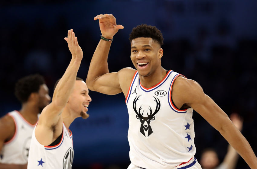 CHARLOTTE, NORTH CAROLINA - FEBRUARY 17: Giannis Antetokounmpo #34 of the Milwaukee Bucks and Team Giannis celebrates with Stephen Curry #30 of the Golden State Warriors against Team LeBron in the second quarter during the NBA All-Star game as part of the 2019 NBA All-Star Weekend at Spectrum Center on February 17, 2019 in Charlotte, North Carolina. NOTE TO USER: User expressly acknowledges and agrees that, by downloading and/or using this photograph, user is consenting to the terms and conditions of the Getty Images License Agreement. (Photo by Streeter Lecka/Getty Images)