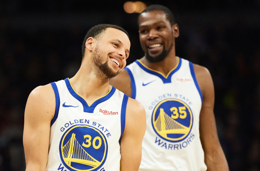 MINNEAPOLIS, MN - MARCH 19: Stephen Curry #30 and Kevin Durant #35 of the Golden State Warriors look on during the game against the Minnesota Timberwolves on March 19, 2019 at the Target Center in Minneapolis, Minnesota. NOTE TO USER: User expressly acknowledges and agrees that, by downloading and or using this Photograph, user is consenting to the terms and conditions of the Getty Images License Agreement. (Photo by Hannah Foslien/Getty Images)