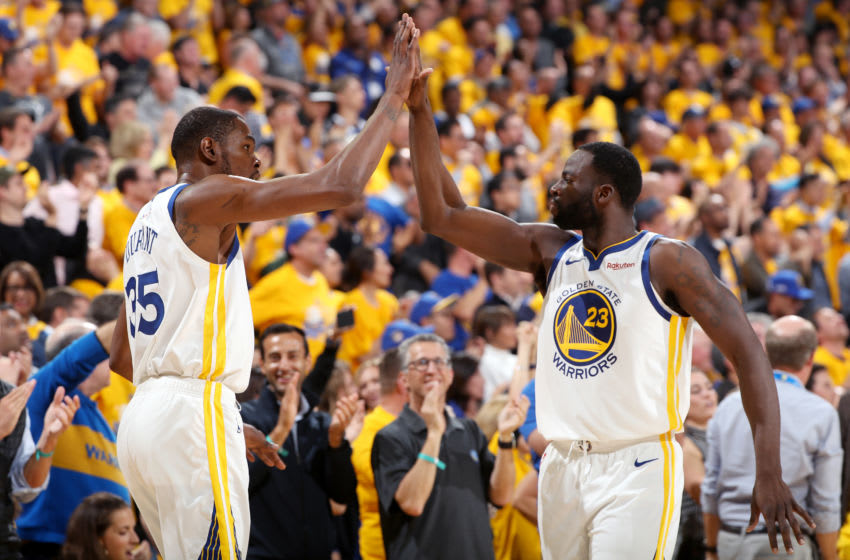 OAKLAND, CA - MAY 8: Kevin Durant #35 and Draymond Green #23 of the Golden State Warriors high five during Game Five of the Western Conference Semifinals of the 2019 NBA Playoffs against the Houston Rockets on May 8, 2019 at ORACLE Arena in Oakland, California. NOTE TO USER: User expressly acknowledges and agrees that, by downloading and/or using this photograph, user is consenting to the terms and conditions of Getty Images License Agreement. Mandatory Copyright Notice: Copyright 2019 NBAE (Photo by Joe Murphy/NBAE via Getty Images)