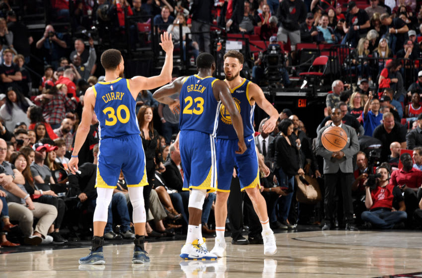 PORTLAND, OR - MAY 18: Stephen Curry #30, Draymond Green #23, and Klay Thompson #11 of the Golden State Warriors celebrate during Game Three of the Western Conference Finals against the Portland Trail Blazers on May 18, 2019 at the Moda Center in Portland, Oregon. NOTE TO USER: User expressly acknowledges and agrees that, by downloading and/or using this photograph, user is consenting to the terms and conditions of the Getty Images License Agreement. Mandatory Copyright Notice: Copyright 2019 NBAE (Photo by Andrew D. Bernstein/NBAE via Getty Images)