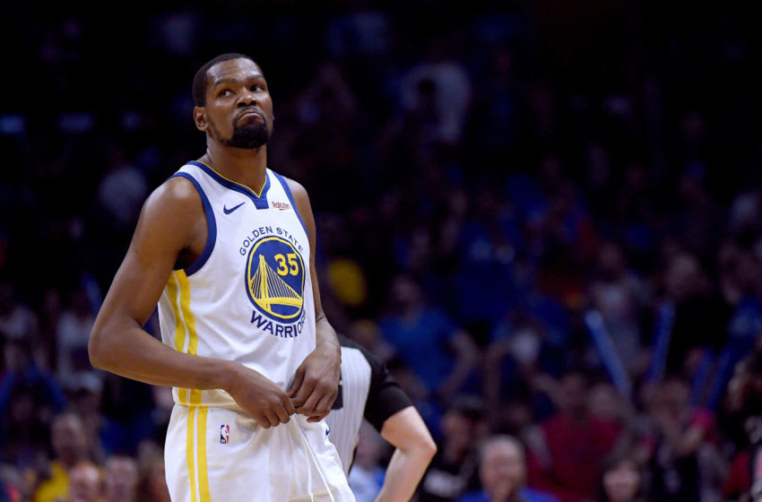 LOS ANGELES, CALIFORNIA - APRIL 26: Kevin Durant #35 of the Golden State Warriors reacts as he leaves the game late in the fourth quarter in a 129-110 win over the LA Clippers during Game Six of Round One of the 2019 NBA Playoffs at Staples Center on April 26, 2019 in Los Angeles, California. (Photo by Harry How/Getty Images) NOTE TO USER: User expressly acknowledges and agrees that, by downloading and or using this photograph, User is consenting to the terms and conditions of the Getty Images License Agreement.