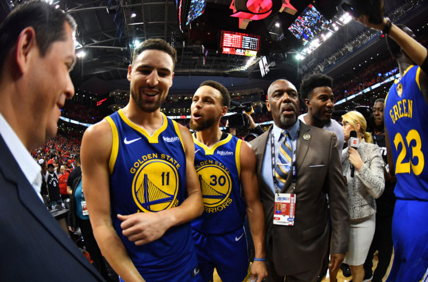 TORONTO, CANADA - JUNE 10: Klay Thompson #11 and Stephen Curry #30 of the Golden State Warriors celebrate after a game against the Toronto Raptors after Game Five of the NBA Finals on June 10, 2019 at Scotiabank Arena in Toronto, Ontario, Canada. NOTE TO USER: User expressly acknowledges and agrees that, by downloading and/or using this photograph, user is consenting to the terms and conditions of the Getty Images License Agreement. Mandatory Copyright Notice: Copyright 2019 NBAE (Photo by Jesse D. Garrabrant/NBAE via Getty Images)