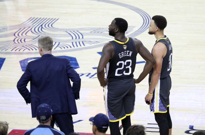 OAKLAND, CA - JUNE 13: Draymond Green #23 and Stephen Curry #30 of the Golden State Warriors look on during Game Six of the NBA Finals on June 13, 2019 at ORACLE Arena in Oakland, California. NOTE TO USER: User expressly acknowledges and agrees that, by downloading and/or using this photograph, user is consenting to the terms and conditions of Getty Images License Agreement. Mandatory Copyright Notice: Copyright 2019 NBAE (Photo by Joe Murphy/NBAE via Getty Images)