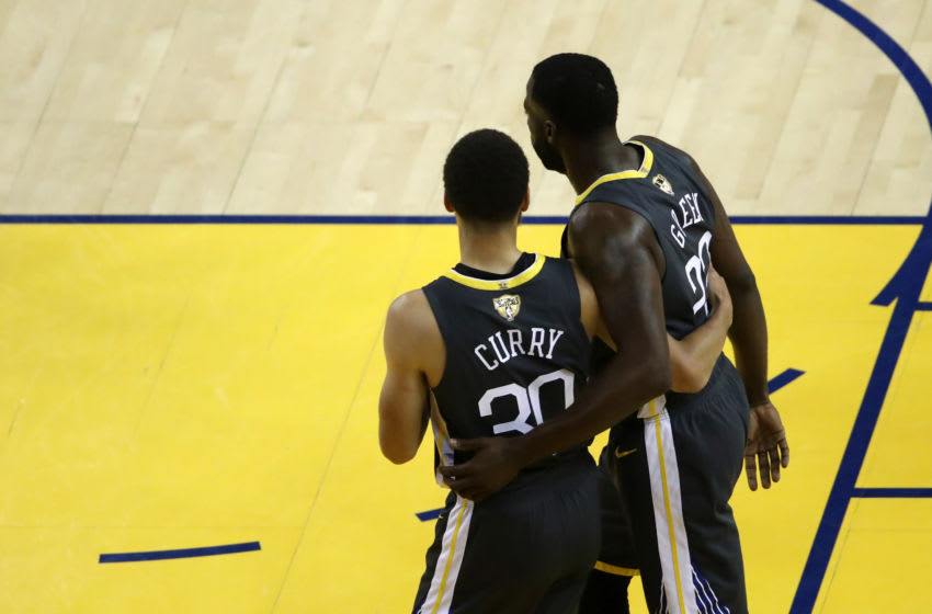 OAKLAND, CALIFORNIA - JUNE 07: Stephen Curry #30 and Draymond Green #23 of the Golden State Warriors celebrate their lead in the first half against the Toronto Raptors during Game Four of the 2019 NBA Finals at ORACLE Arena on June 07, 2019 in Oakland, California. NOTE TO USER: User expressly acknowledges and agrees that, by downloading and or using this photograph, User is consenting to the terms and conditions of the Getty Images License Agreement. (Photo by Ezra Shaw/Getty Images)