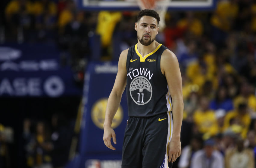 OAKLAND, CALIFORNIA - JUNE 07: Klay Thompson #11 of the Golden State Warriors reacts against the Toronto Raptors during Game Four of the 2019 NBA Finals at ORACLE Arena on June 07, 2019 in Oakland, California. NOTE TO USER: User expressly acknowledges and agrees that, by downloading and or using this photograph, User is consenting to the terms and conditions of the Getty Images License Agreement. (Photo by Ezra Shaw/Getty Images)