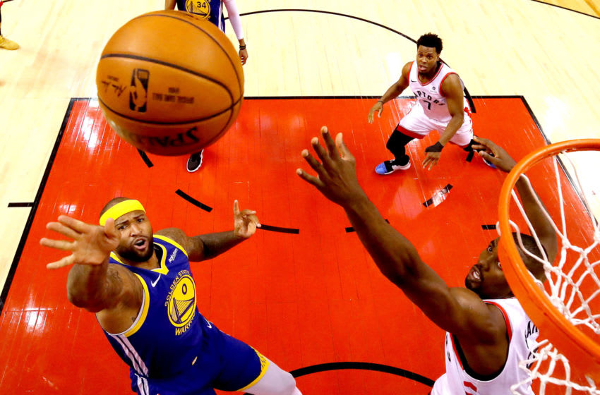 TORONTO, ONTARIO - JUNE 10: DeMarcus Cousins #0 of the Golden State Warriors attempts a shot Serge Ibaka #9 of the Toronto Raptors during Game Five of the 2019 NBA Finals at Scotiabank Arena on June 10, 2019 in Toronto, Canada. NOTE TO USER: User expressly acknowledges and agrees that, by downloading and or using this photograph, User is consenting to the terms and conditions of the Getty Images License Agreement. (Photo by Gregory Shamus/Getty Images)