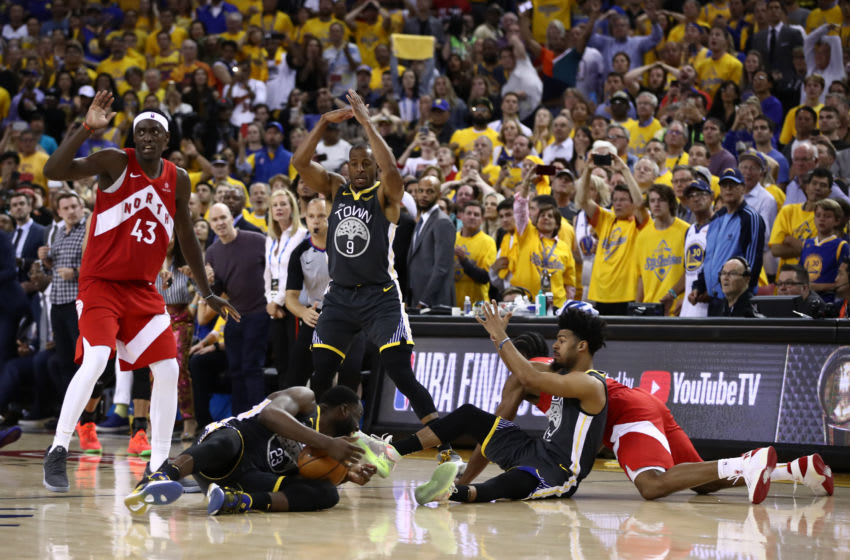 OAKLAND, CALIFORNIA - JUNE 13: Draymond Green #23 of the Golden State Warriors is called for a technical foul for calling a timeout with none remaining against the Toronto Raptors during Game Six of the 2019 NBA Finals at ORACLE Arena on June 13, 2019 in Oakland, California. NOTE TO USER: User expressly acknowledges and agrees that, by downloading and or using this photograph, User is consenting to the terms and conditions of the Getty Images License Agreement. (Photo by Ezra Shaw/Getty Images)