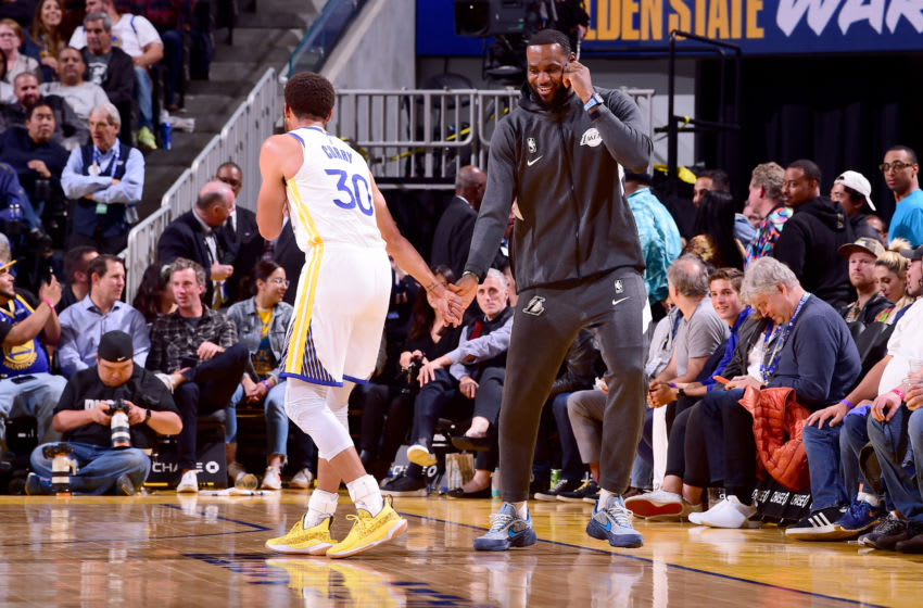 SAN FRANCISCO, CA - OCTOBER 18: Stephen Curry #30 of the Golden State Warriors talks with LeBron James #23 of the Los Angeles Lakers during a pre-season game on October 18, 2019 at Chase Center in San Francisco, California. NOTE TO USER: User expressly acknowledges and agrees that, by downloading and or using this photograph, User is consenting to the terms and conditions of the Getty Images License Agreement. Mandatory Copyright Notice: Copyright 2019 NBAE (Photo by Noah Graham/NBAE via Getty Images)