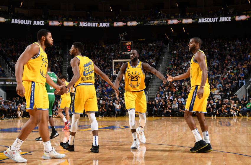 SAN FRANCISCO, CA - NOVEMBER 15: Draymond Green #23 of the Golden State Warriors hi-fives team mates during the game against the Boston Celtics on November 15, 2019 at Chase Center in San Francisco, California. NOTE TO USER: User expressly acknowledges and agrees that, by downloading and or using this photograph, user is consenting to the terms and conditions of Getty Images License Agreement. Mandatory Copyright Notice: Copyright 2019 NBAE (Photo by Noah Graham/NBAE via Getty Images)