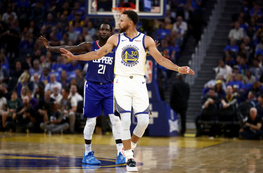 SAN FRANCISCO, CALIFORNIA - OCTOBER 24: Stephen Curry #30 of the Golden State Warriors and Patrick Beverley #21 of the LA Clippers talk to the officials at Chase Center on October 24, 2019 in San Francisco, California. NOTE TO USER: User expressly acknowledges and agrees that, by downloading and or using this photograph, User is consenting to the terms and conditions of the Getty Images License Agreement. (Photo by Ezra Shaw/Getty Images)