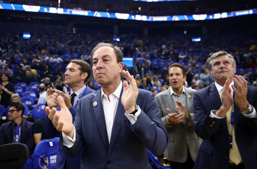 SAN FRANCISCO, CALIFORNIA - OCTOBER 24: (L-R) Golden State Warriors owners Joe Lacob and Peter Guber stand with team president and COO Rick Welts before their game against the LA Clippers at Chase Center on October 24, 2019 in San Francisco, California. NOTE TO USER: User expressly acknowledges and agrees that, by downloading and or using this photograph, User is consenting to the terms and conditions of the Getty Images License Agreement. (Photo by Ezra Shaw/Getty Images)