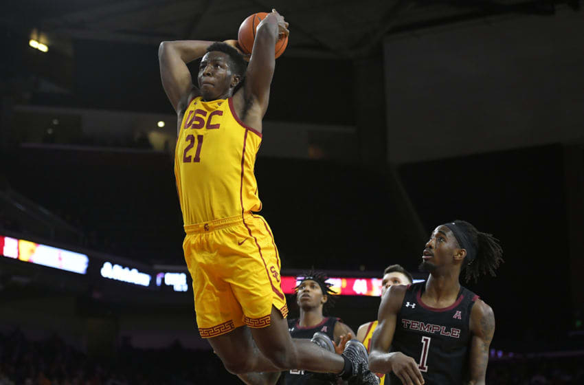 LOS ANGELES, CA - NOVEMBER 22: Onyeka Okongwu #21 of the USC Trojans gets past Quinton Rose #1 of the Temple Owls for a dunk in the second half at Galen Center on November 22, 2019 in Los Angeles, California. (Photo by John McCoy/Getty Images)