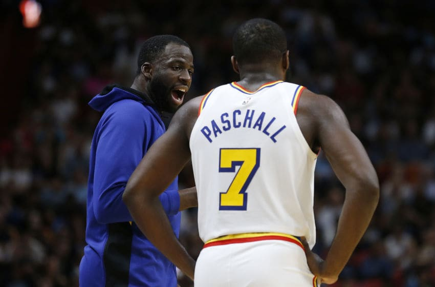 MIAMI, FLORIDA - NOVEMBER 29: Draymond Green #23 of the Golden State Warriors talks to Eric Paschall #7 against the Miami Heat during the second half at American Airlines Arena on November 29, 2019 in Miami, Florida. NOTE TO USER: User expressly acknowledges and agrees that, by downloading and/or using this photograph, user is consenting to the terms and conditions of the Getty Images License Agreement. (Photo by Michael Reaves/Getty Images)