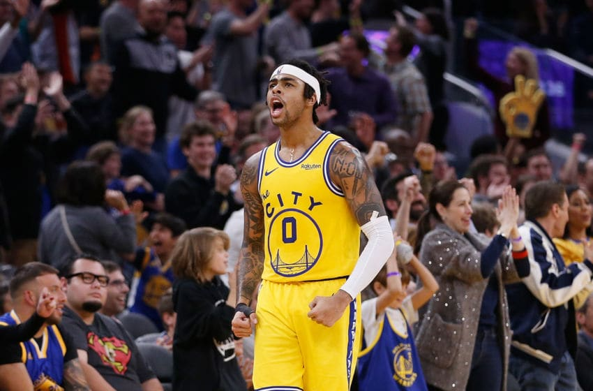 SAN FRANCISCO, CALIFORNIA - DECEMBER 27: D'Angelo Russell #0 of the Golden State Warriors celebrates after a basket in the second half against the Phoenix Suns at Chase Center on December 27, 2019 in San Francisco, California. NOTE TO USER: User expressly acknowledges and agrees that, by downloading and/or using this photograph, user is consenting to the terms and conditions of the Getty Images License Agreement. (Photo by Lachlan Cunningham/Getty Images)
