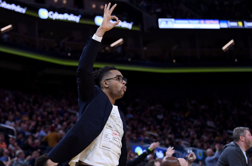 SAN FRANCISCO, CALIFORNIA - JANUARY 08: D'Angelo Russell #0 of the Golden State Warriors reacts off the bench after a teammate made a three-point shot against Milwaukee Bucks during the second half of an NBA basketball game at Chase Center on January 08, 2020 in San Francisco, California. NOTE TO USER: User expressly acknowledges and agrees that, by downloading and or using this photograph, User is consenting to the terms and conditions of the Getty Images License Agreement. (Photo by Thearon W. Henderson/Getty Images)