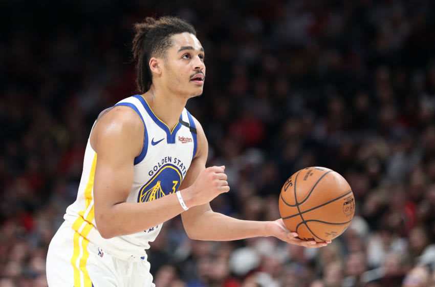 PORTLAND, OREGON - JANUARY 20: Jordan Poole #3 of the Golden State Warriors looks to shoot a free throw in the third quarter against the Portland Trail Blazers during their game at Moda Center on January 20, 2020 in Portland, Oregon. NOTE TO USER: User expressly acknowledges and agrees that, by downloading and or using this photograph, User is consenting to the terms and conditions of the Getty Images License Agreement (Photo by Abbie Parr/Getty Images) (Photo by Abbie Parr/Getty Images)
