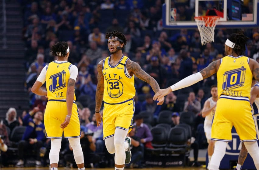 SAN FRANCISCO, CALIFORNIA - JANUARY 24: Marquese Chriss #32 of the Golden State Warriors celebrates after a basket with Damion Lee #1 and D'Angelo Russell #0 in the first half against the Indiana Pacers at Chase Center on January 24, 2020 in San Francisco, California. NOTE TO USER: User expressly acknowledges and agrees that, by downloading and/or using this photograph, user is consenting to the terms and conditions of the Getty Images License Agreement. (Photo by Lachlan Cunningham/Getty Images)