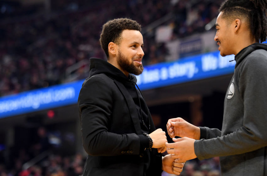CLEVELAND, OHIO - FEBRUARY 01: Stephen Curry #30 talks with Jordan Poole #3 of the Golden State Warriors during the first half against the Cleveland Cavaliers at Rocket Mortgage Fieldhouse on February 01, 2020 in Cleveland, Ohio. NOTE TO USER: User expressly acknowledges and agrees that, by downloading and/or using this photograph, user is consenting to the terms and conditions of the Getty Images License Agreement. (Photo by Jason Miller/Getty Images)