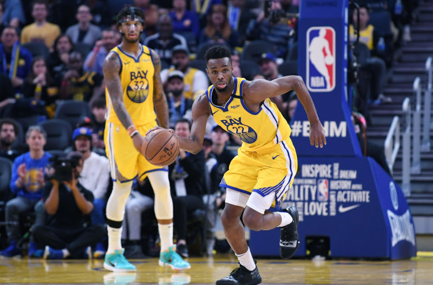 SAN FRANCISCO, CALIFORNIA - FEBRUARY 08: Andrew Wiggins #22 of the Golden State Warriors dribbles the ball up court against the Los Angeles Lakers during the second half of an NBA basketball game at Chase Center on February 08, 2020 in San Francisco, California. NOTE TO USER: User expressly acknowledges and agrees that, by downloading and or using this photograph, User is consenting to the terms and conditions of the Getty Images License Agreement. (Photo by Thearon W. Henderson/Getty Images)