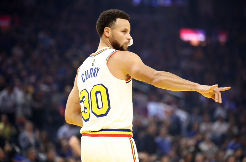 SAN FRANCISCO, CALIFORNIA - MARCH 05: Stephen Curry #30 of the Golden State Warriors motions to the Toronto Raptors bench before their game at Chase Center on March 05, 2020 in San Francisco, California. NOTE TO USER: User expressly acknowledges and agrees that, by downloading and or using this photograph, User is consenting to the terms and conditions of the Getty Images License Agreement. (Photo by Ezra Shaw/Getty Images)
