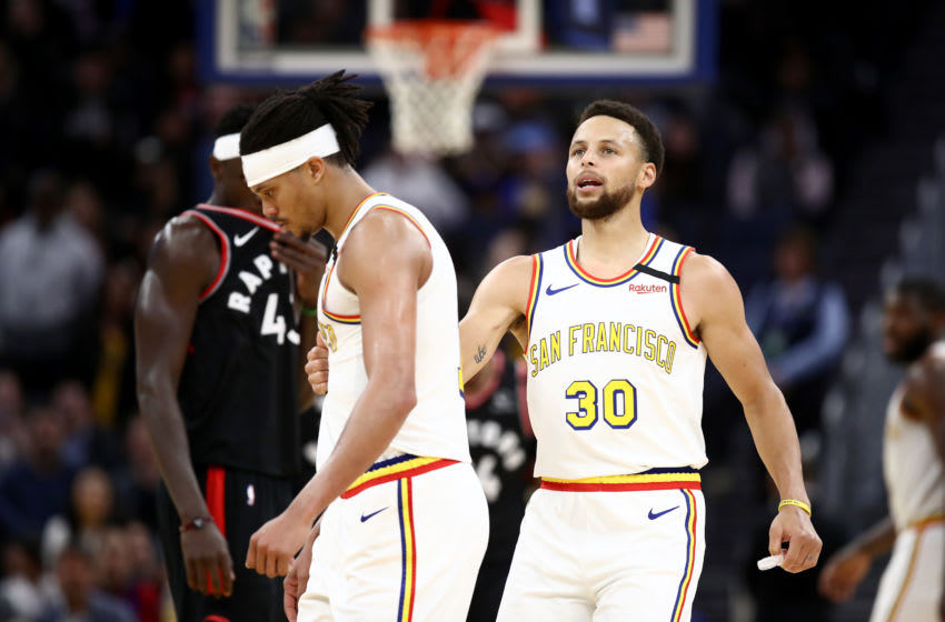 SAN FRANCISCO, CALIFORNIA - MARCH 05: Stephen Curry #30 talks to Damion Lee #1 of the Golden State Warriors after Lee missed two free throws in the final minute of their loss to the Toronto Raptors at Chase Center on March 05, 2020 in San Francisco, California. NOTE TO USER: User expressly acknowledges and agrees that, by downloading and or using this photograph, User is consenting to the terms and conditions of the Getty Images License Agreement. (Photo by Ezra Shaw/Getty Images)