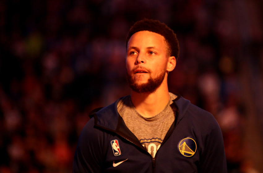 SAN FRANCISCO, CALIFORNIA - MARCH 05: Stephen Curry #30 of the Golden State Warriors stands for the National Anthem before their game against the Toronto Raptors at Chase Center on March 05, 2020 in San Francisco, California. NOTE TO USER: User expressly acknowledges and agrees that, by downloading and or using this photograph, User is consenting to the terms and conditions of the Getty Images License Agreement. (Photo by Ezra Shaw/Getty Images)