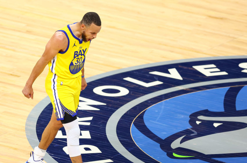 MINNEAPOLIS, MN - APRIL 29: Stephen Curry #30 of the Golden State Warriors reacts out of frustration at the end of the first quarter against the Minnesota Timberwolves at Target Center on April 29, 2021 in Minneapolis, Minnesota. NOTE TO USER: User expressly acknowledges and agrees that, by downloading and or using this photograph, User is consenting to the terms and conditions of the Getty Images License Agreement. (Photo by Harrison Barden/Getty Images)