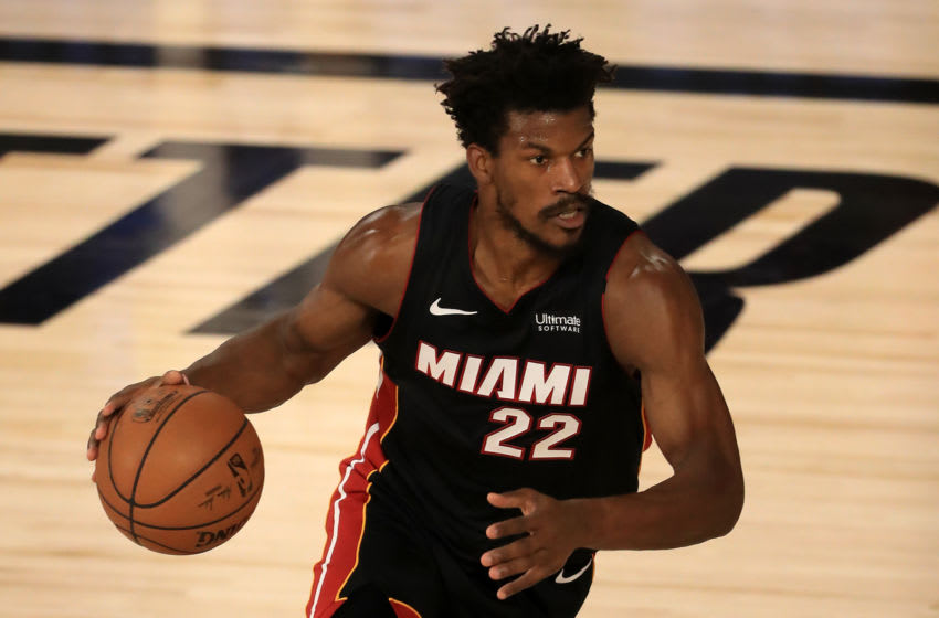 LAKE BUENA VISTA, FLORIDA - SEPTEMBER 04: Jimmy Butler #22 of the Miami Heat dribbles the ball during the first quarter against the Milwaukee Bucks in Game Three of the Eastern Conference Second Round during the 2020 NBA Playoffs at the Field House at the ESPN Wide World Of Sports Complex on September 04, 2020 in Lake Buena Vista, Florida. NOTE TO USER: User expressly acknowledges and agrees that, by downloading and or using this photograph, User is consenting to the terms and conditions of the Getty Images License Agreement. (Photo by Mike Ehrmann/Getty Images)