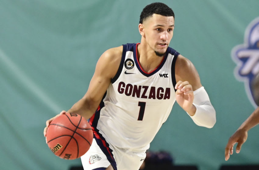 FORT MYERS, FLORIDA - NOVEMBER 27: Jalen Suggs #1 of the Gonzaga Bulldogs dribbles the ball during the second half against the Auburn Tigers during the Rocket Mortgage Fort Myers Tip-Off at Suncoast Credit Union Arena on November 27, 2020 in Fort Myers, Florida. (Photo by Douglas P. DeFelice/Getty Images)