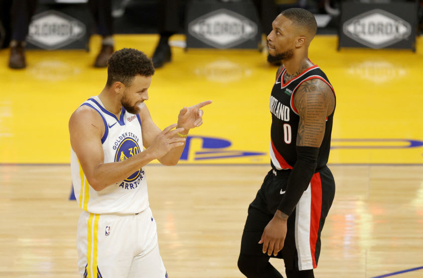 SAN FRANCISCO, CALIFORNIA - JANUARY 01: Stephen Curry #30 of the Golden State Warriors reacts in front of Damian Lillard #0 of the Portland Trail Blazers at Chase Center on January 01, 2021 in San Francisco, California. NOTE TO USER: User expressly acknowledges and agrees that, by downloading and or using this photograph, User is consenting to the terms and conditions of the Getty Images License Agreement. (Photo by Ezra Shaw/undefined)
