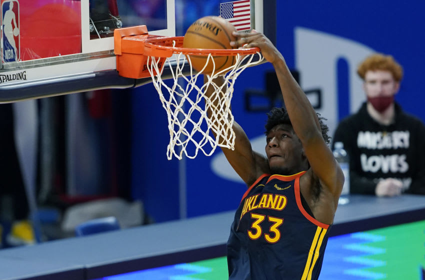 SAN FRANCISCO, CALIFORNIA - JANUARY 20: James Wiseman #33 of the Golden State Warriors goes up for a slam dunk against the San Antonio Spurs during the second half of an NBA basketball game at Chase Center on January 20, 2021 in San Francisco, California. NOTE TO USER: User expressly acknowledges and agrees that, by downloading and or using this photograph, User is consenting to the terms and conditions of the Getty Images License Agreement. (Photo by Thearon W. Henderson/Getty Images)