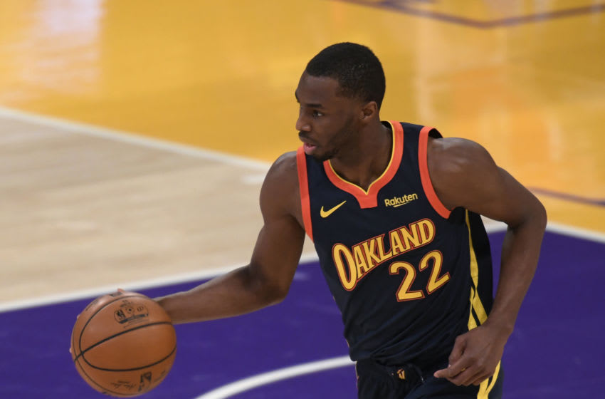 LOS ANGELES, CALIFORNIA - FEBRUARY 28: Andrew Wiggins #22 of the Golden State Warriors controls the ball during a 117-91 Los Angeles Lakers win at Staples Center on February 28, 2021 in Los Angeles, California. (Photo by Harry How/Getty Images) NOTE TO USER: User expressly acknowledges and agrees that, by downloading and/or using this Photograph, user is consenting to the terms and conditions of the Getty Images License Agreement. Mandatory Copyright Notice: Copyright 2021 NBAE.