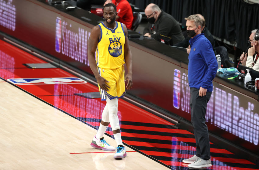 PORTLAND, OREGON - MARCH 03: Draymond Green #23 and head coach Steve Kerr of the Golden State Warriors have a conversation in the second quarter against the Portland Trail Blazers at Moda Center on March 03, 2021 in Portland, Oregon. NOTE TO USER: User expressly acknowledges and agrees that, by downloading and or using this photograph, User is consenting to the terms and conditions of the Getty Images License Agreement. (Photo by Abbie Parr/Getty Images)
