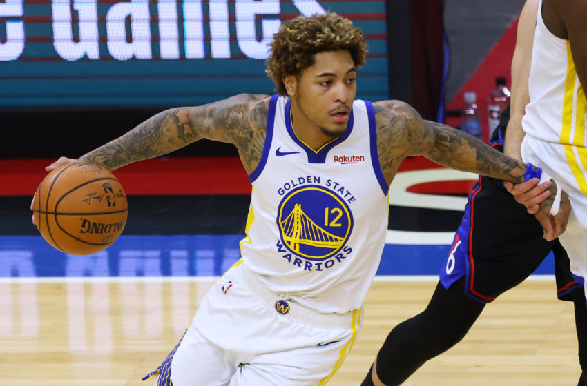 PHILADELPHIA, PA - APRIL 19: Kelly Oubre Jr. #12 of the Golden State Warriors in action against the Philadelphia 76ers during an NBA basketball game at Wells Fargo Center on April 19, 2021 in Philadelphia, Pennsylvania. The Warriors defeated the 76ers 107-96. (Photo by Rich Schultz/Getty Images)