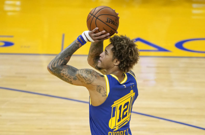 SAN FRANCISCO, CALIFORNIA - APRIL 27: Kelly Oubre Jr. #12 of the Golden State Warriors stands at the line to shoot a foul shot against the Dallas Mavericks during the first half of an NBA basketball game at Chase Center on April 27, 2021 in San Francisco, California. NOTE TO USER: User expressly acknowledges and agrees that, by downloading and or using this photograph, User is consenting to the terms and conditions of the Getty Images License Agreement. (Photo by Thearon W. Henderson/Getty Images)