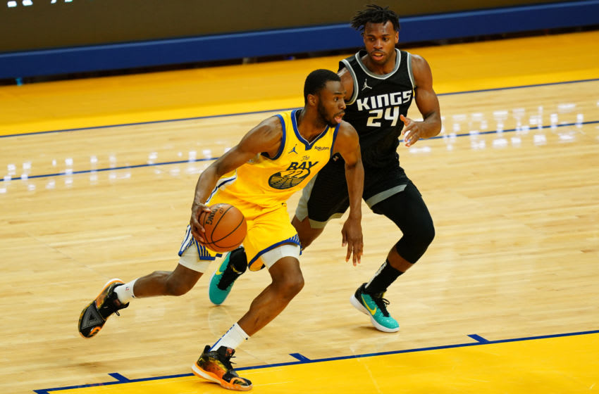 SAN FRANCISCO, CALIFORNIA - APRIL 25: Andrew Wiggins #22 of the Golden State Warriors handles the ball against Buddy Hield #24 of the Sacramento Kings during the game at Chase Center on April 25, 2021 in San Francisco, California. NOTE TO USER: User expressly acknowledges and agrees that, by downloading and or using this photograph, User is consenting to the terms and conditions of the Getty Images License Agreement. (Photo by Daniel Shirey/Getty Images)