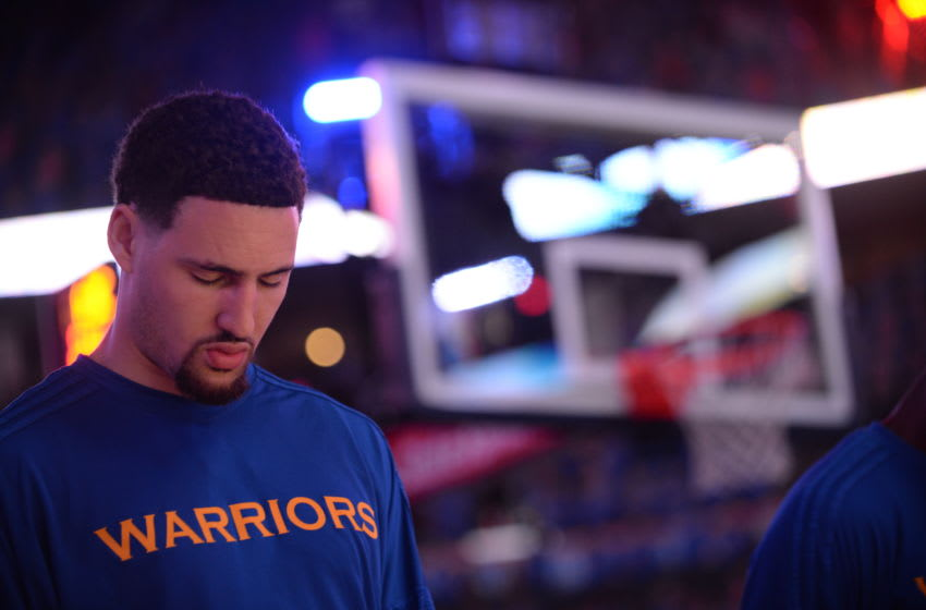 OKLAHOMA CITY, OK- MAY 28: Klay Thompson #11 of the Golden State Warriors stands for the national anthem before the game against the Oklahoma City Thunder in Game Six of the Western Conference Finals during the 2016 NBA Playoffs on May 28, 2016 at Chesapeake Energy Arena in Oklahoma City, Oklahoma. NOTE TO USER: User expressly acknowledges and agrees that, by downloading and or using this photograph, User is consenting to the terms and conditions of the Getty Images License Agreement. Mandatory Copyright Notice: Copyright 2016 NBAE (Photo by Noah Graham/NBAE via Getty Images)
